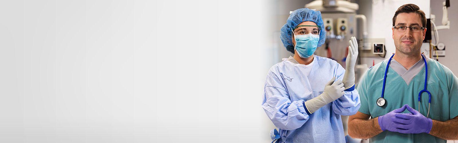 Surgeon and nurse wearing gloves.