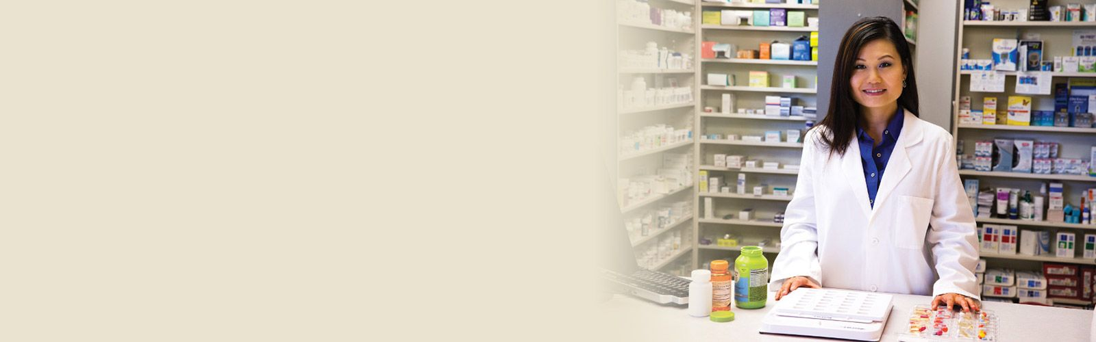 A pharmacist sorting and organizing several prescriptions