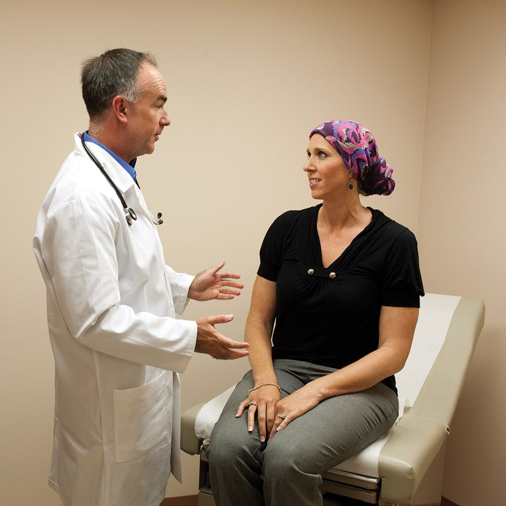 doctor meeting with clinical patient wearing scarf on head