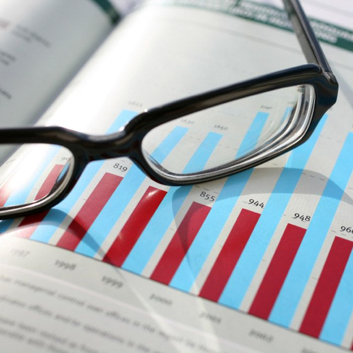 pair of glasses sitting on top of market insights document