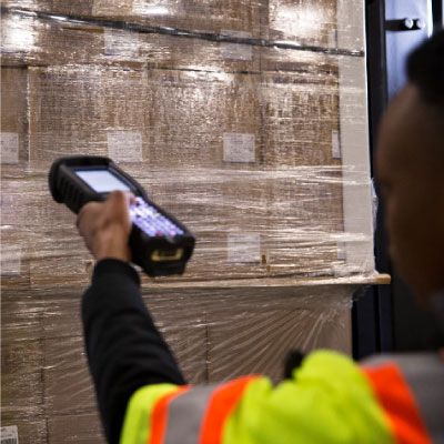 warehouse associate scanning shipment with device