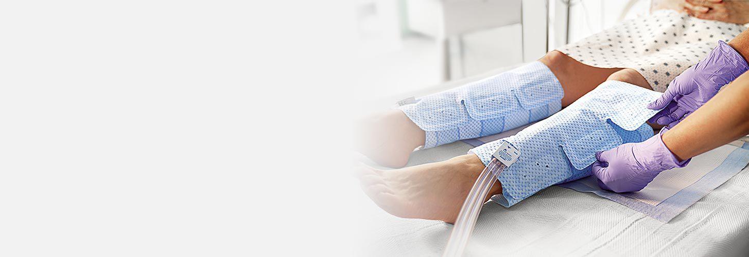 Nurse adjusting IPC device sleeves.
