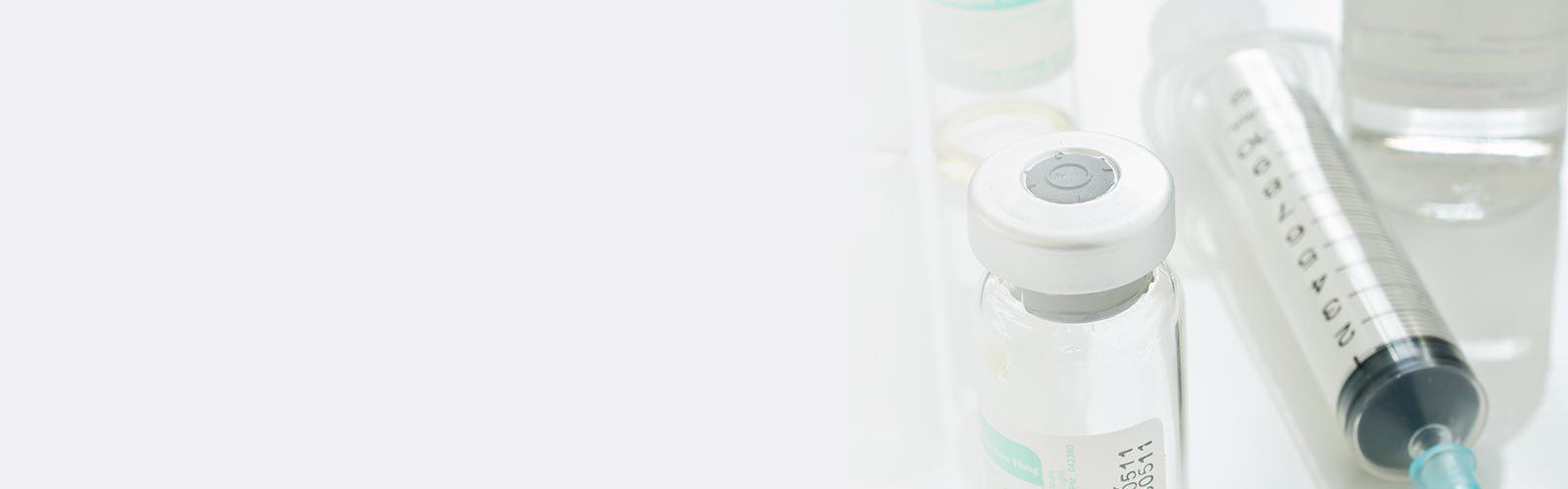 Syringe and medical vials.