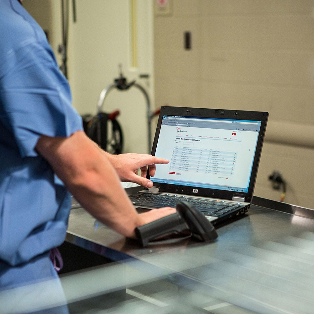 Medical professional using a laptop computer.