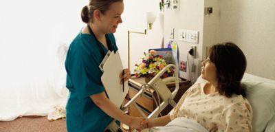 Nurse holding a patient's hand.