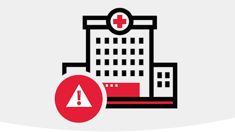 Illustration of hospital with red warning sign.