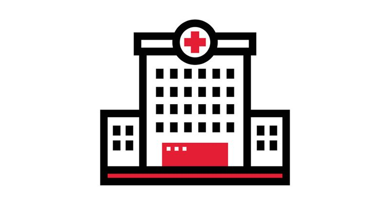 Hospital icon on red background.