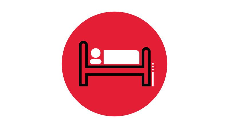 Patient in bed icon.