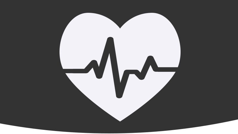Illustration of a white heart on a black background with heartbeat graph over top of heart.