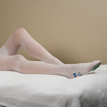 Legs of patient in hospital bed wearing T.E.D.™ Anti-Embolism Stockings - Thigh Length.