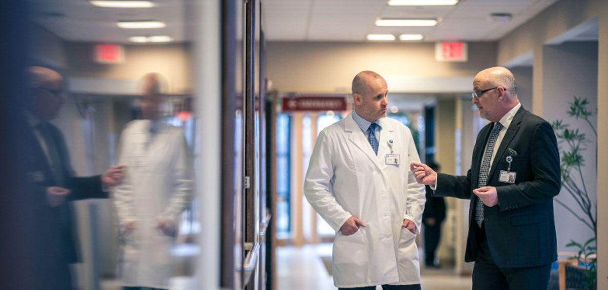 Doctors talking in a hallway.