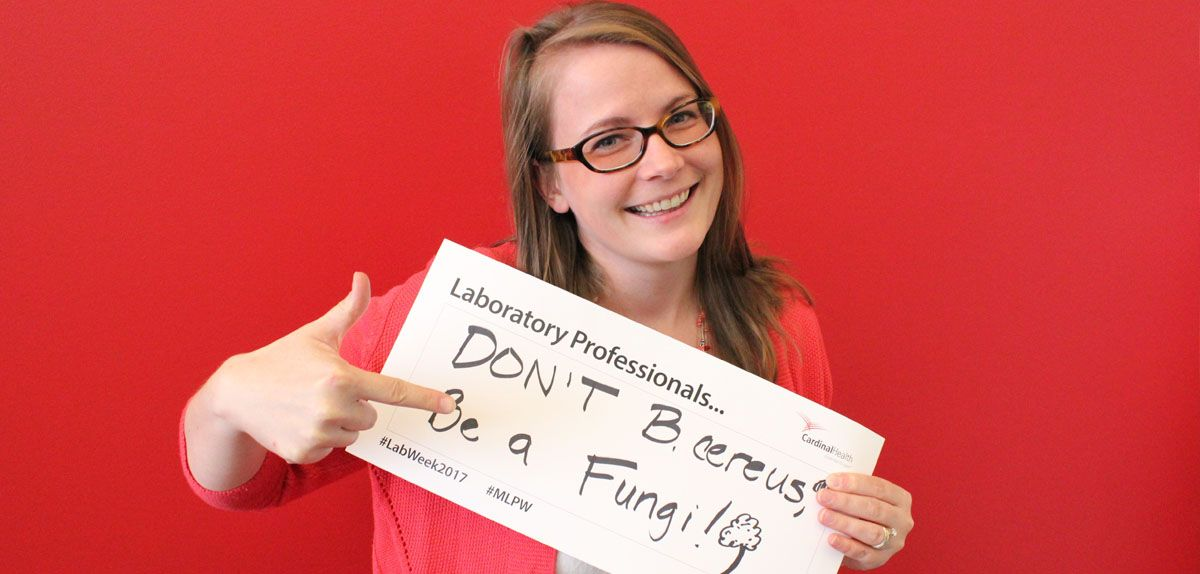 cardinal health employee holding a sign with a lab pun