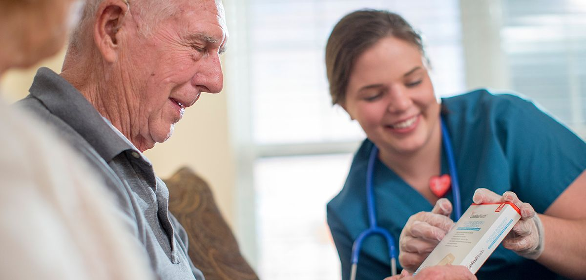 Nurse and patient talking about a product.
