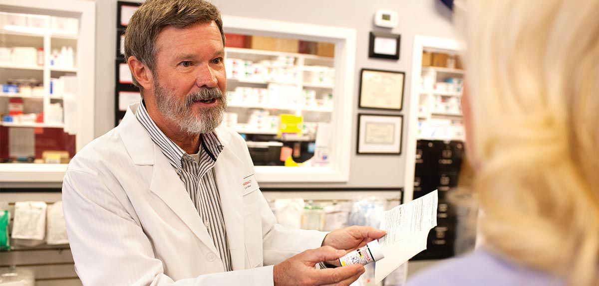 Pharmacist talking to a patient about her prescription.