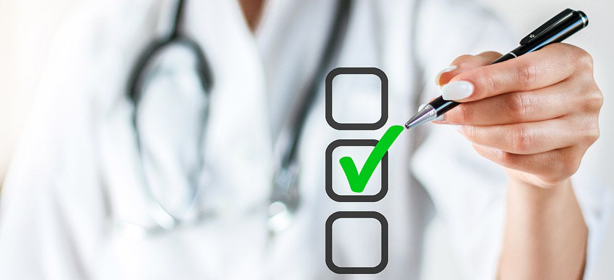 Image of a doctor checking off a box in a checklist