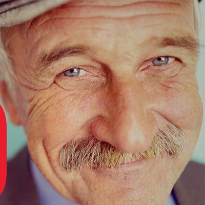 Smiling man with a mustache.