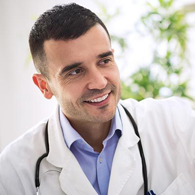 Doctor with stethoscope around neck.