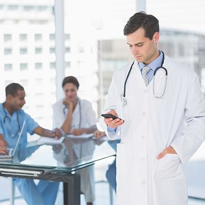 physicians in hospital meeting room reviewing information