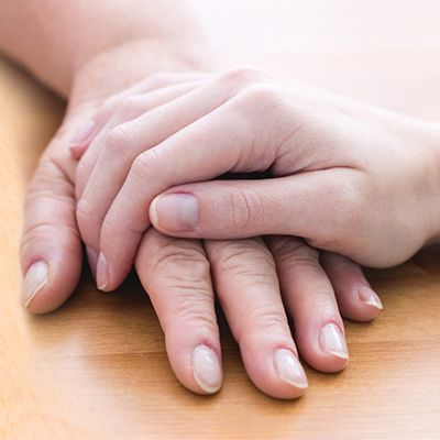 Hands on a table.