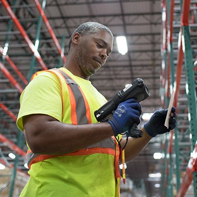 Warehouse associate scanning a label.