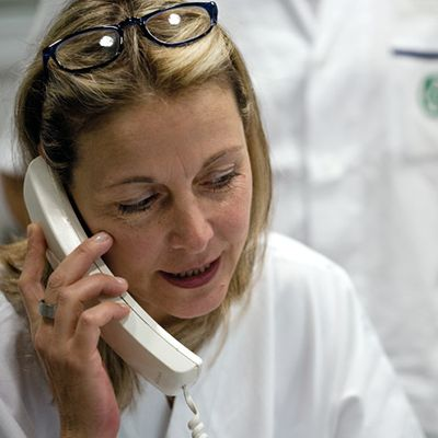 Pharmacist on phone.