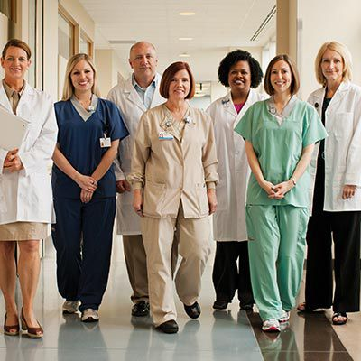 Group of medical professionals standing in the hospital hallway.