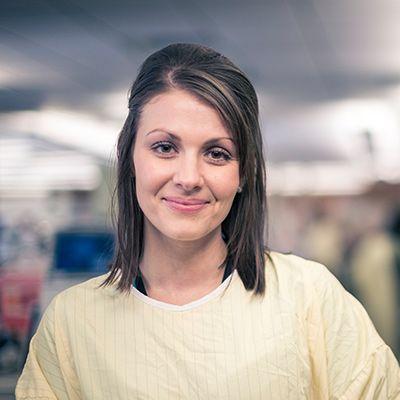 Headshot of laboratory professional smiling.