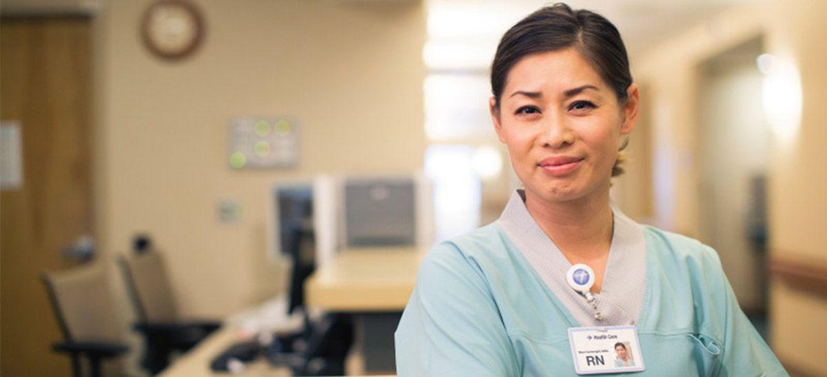 Nurse in teal scrubs.