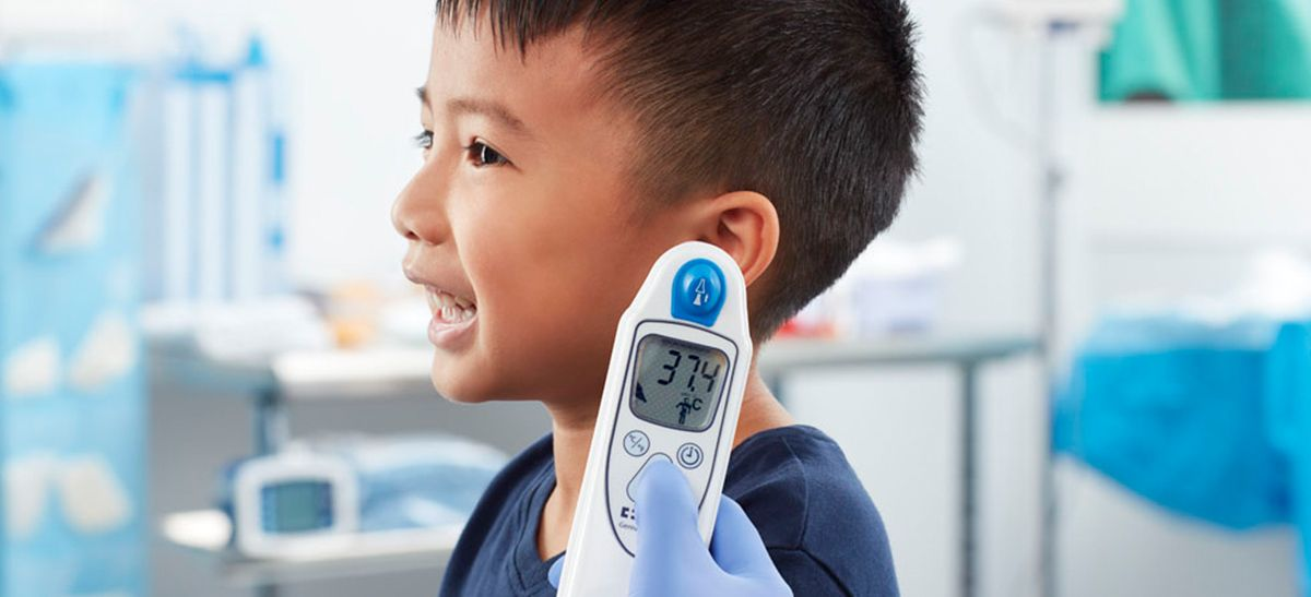 Boy having his temperature taken with the Genius™ 3 Tympanic Thermometer.