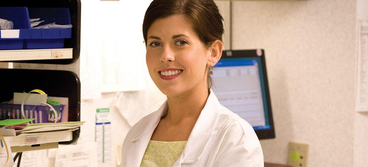 pharmacist in pharmacy, smiling