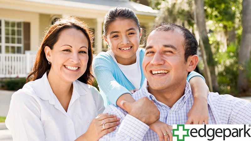 Smiling family of three with Edgepark logo.
