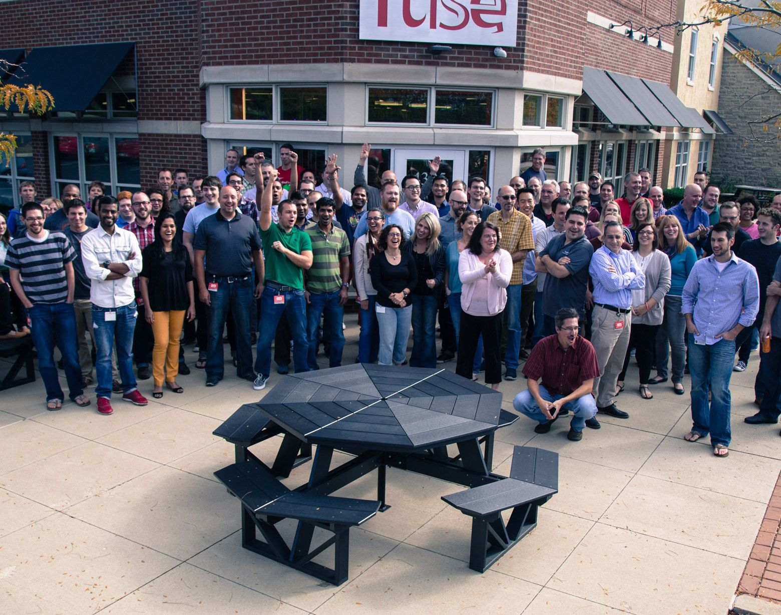 large group of associates outside Fuse building
