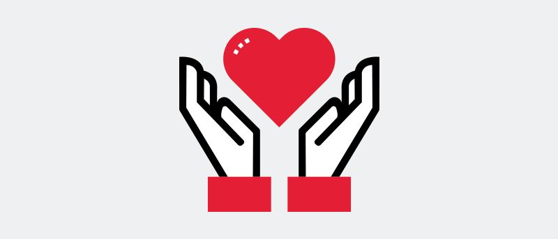Icon illustration of outstretched hands and a heart.