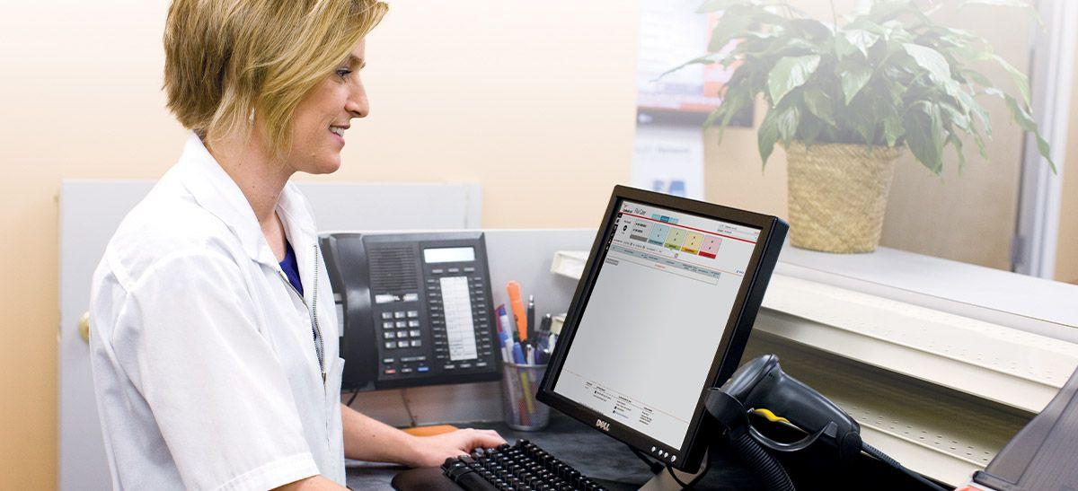 Nurse using computer.