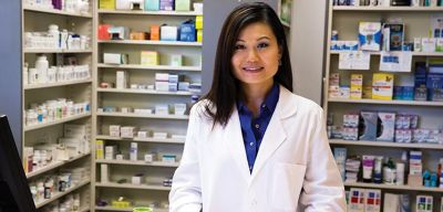 Pharmacist behind the Pharmacy counter.