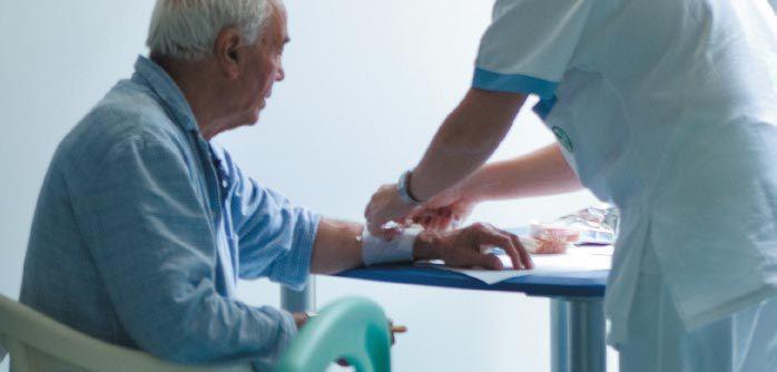 Nurse checking a patient's bandage.