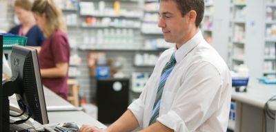 Pharmacist working on a computer.