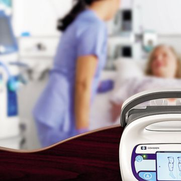 Smart Compression controller with nurse and patient in background.