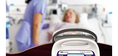 Smart compression device with nurse and patient in the background.