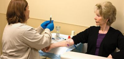 Nurse administering medication in an I.V.
