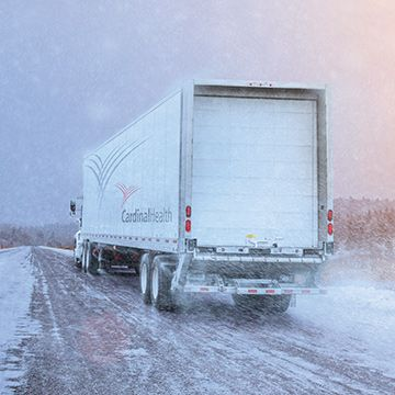 Cardinal Health truck driving in snow.