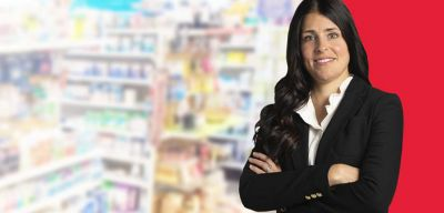 Administrator standing in front of pharmacy product.