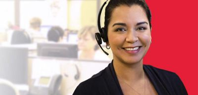 Customer service rep wearing a headset.