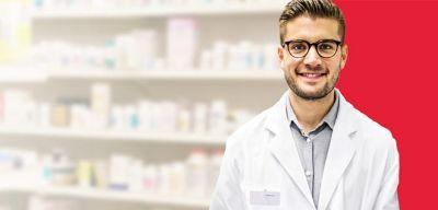 Pharmacist wearing a white coat.