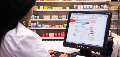 Pharmacist ordering from an online ordering system.