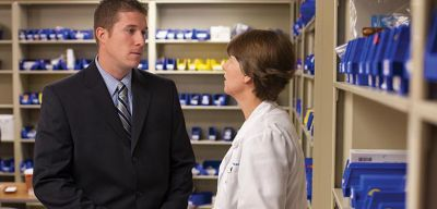 Sales rep talking to a hospital pharmacist.