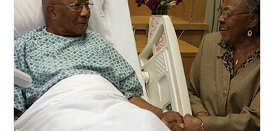 Woman visiting her husband in the hospital.